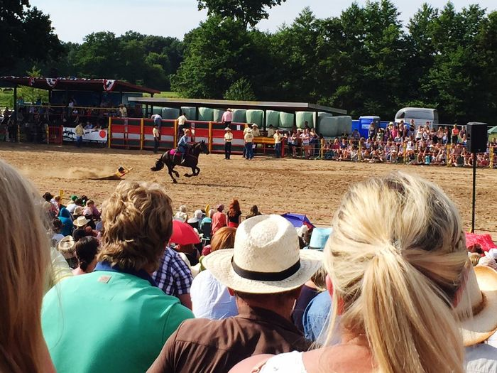 Spectators Looking At Performers Doing Stunt On Horse