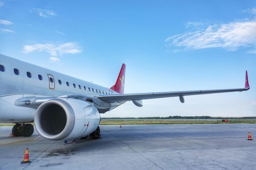China Photos Travel Plane Rural Scene Airplane Transportation Airport Travel Air Vehicle Commercial Airplane Tianjin Airlines Airport Runway Business Finance And Industry Aircraft Wing Flying Mode Of Transport Aerospace Industry Jet Engine Technology Stationary Outdoors Day Sky No People