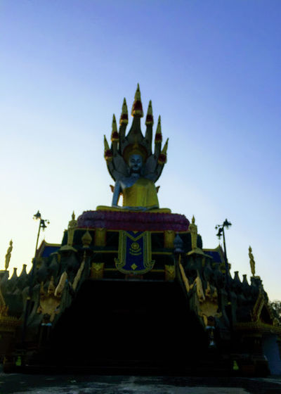 Dragon over the monk Ancient Architecture Clear Sky Day Gold History Nautical Vessel No People Outdoors Place Of Worship Religion Sculpture Sky Spirituality Statue Transportation