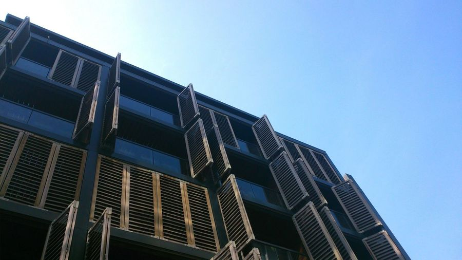 Modern flats in the city, Manchester. Architecture Low Angle View Building Exterior Built Structure No People Sky Outdoors Modern Day Flats Apartment Buildings Wooden Screen Wooden Shutters Stylish Architecture Modern Architecture
