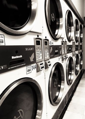 Washing Machine Laundry Laundromat Machinery Modern No People Dryer  Indoors  Close-up Utility Room Day Chores In A Row Dryers Urban Black & White Doing Laundry Machines Tumble Dryer Perspective Convenience