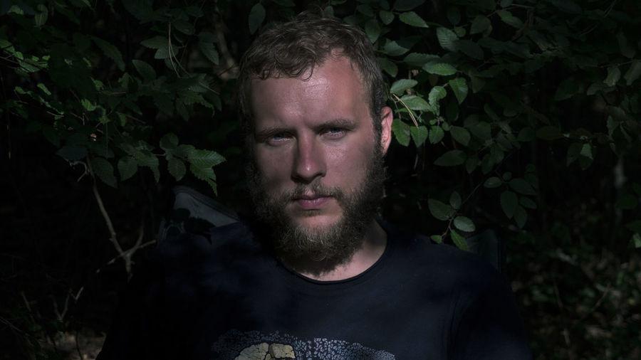 Portrait of man against plants
