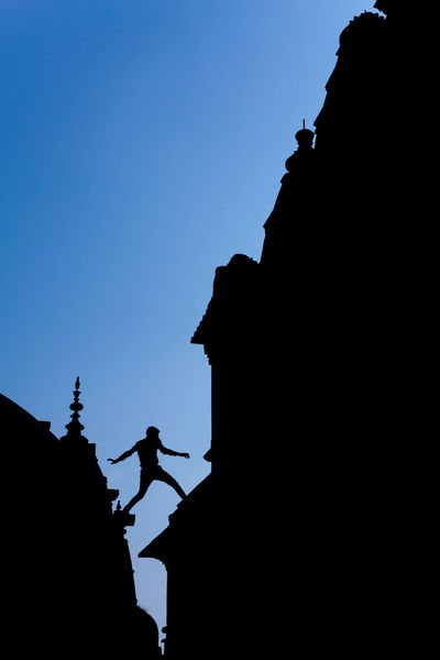 Silhouette of unidentified young man jump over roof of Ram Raja Mandir, located at Orchha, India. Architecture ASIA India Indian Outdoors People Religion Silhouette Temple Travel