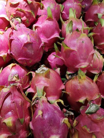 Full frame shot of pink fruits for sale at market stall