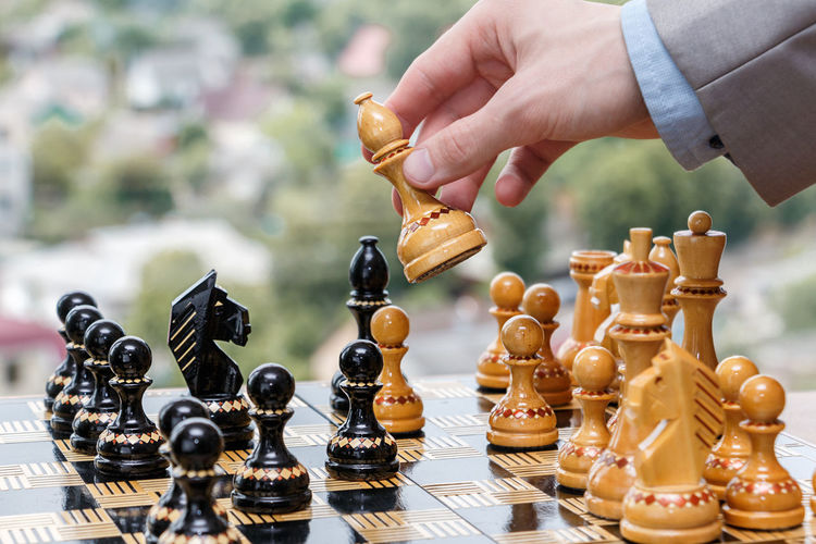chess pieces on a chessboard Achievement Business Chess Player Chessboard Teamwork Win Achievements Battle Businessman Career Checkmate Chess Chess Board Competition Decision Game Goal Mate Play Chess Solution Strategy Success Team Winning Business Relationship Brainstorming Finish Line  Business Meeting First Place  Medal