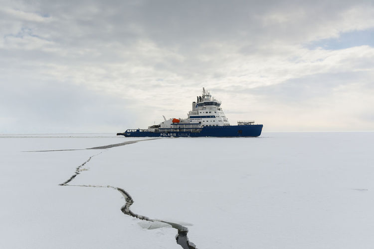 Ship in sea against sky during winter