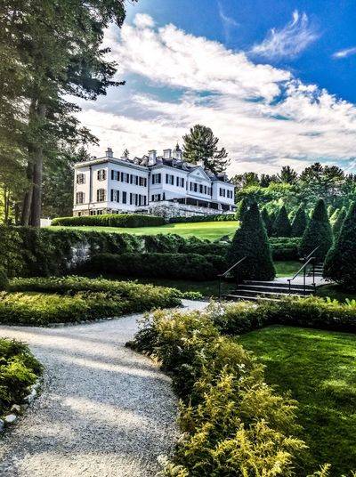 A beautiful landscape shot of the Edith Wharton mansion, a historic building and landmark in Massachusetts. Edith Wharton Estate Historical Building Luxurylifestyle  Mansion House Sky And Clouds Architecture Building Exterior Built Structure Cloud - Sky Day Grass Growth Landscape_photography Landscapes Nature No People Outdoors Plant Sky Sky And Trees Travel Destinations Tree Water