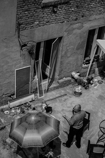High angle view of man working on building