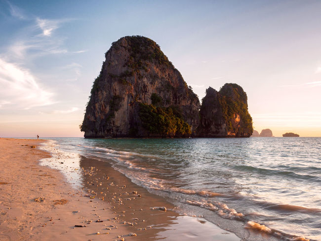 Railay beach at sunset Beach Cliff Landscape Nature Outdoors Railay Railay Beach Rock Formation Rock Formation Scenics Sea Shore Sunset Thailand Tranquility Travel Travel Destinations