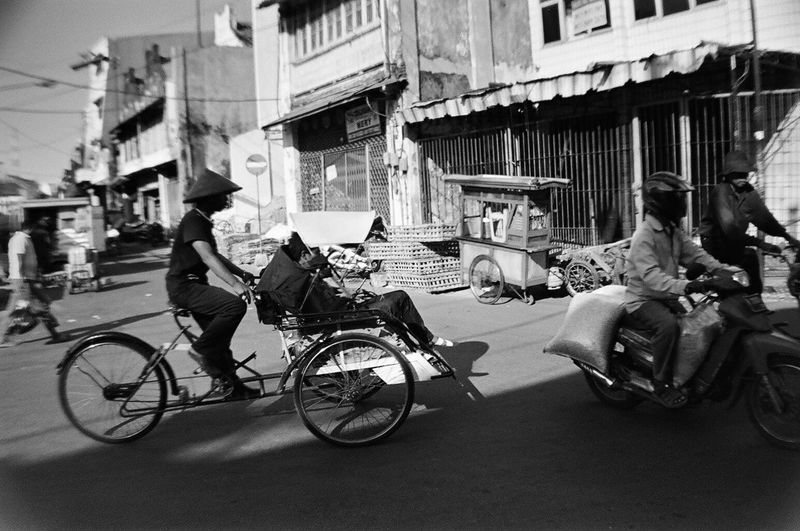 everyday life flows through a historic market square -- surabaya java 35mm Film Analogue Photography Architecture B&w Street Photography Becak Bicycles Blackandwhite Building Exterior City Life City Street Everybodystreet Filmisnotdead INDONESIA Lifestyles Mode Of Transport Street Photography Streetphotography Surabaya The Street Photographer - 2016 EyeEm Awards Travel Photography My Commute