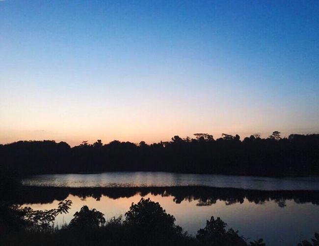 Scenic shot of calm lake against sky