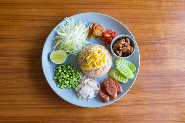 Rice Mixed with Shrimp paste Asian Food Close-up Day Dish Food Food And Drink Freshness Gourmet Healthy Eating Meal No People Plate Ready-to-eat Rice Salad Shrimp Paste Table Thaifood Top Top View Top View Of Food