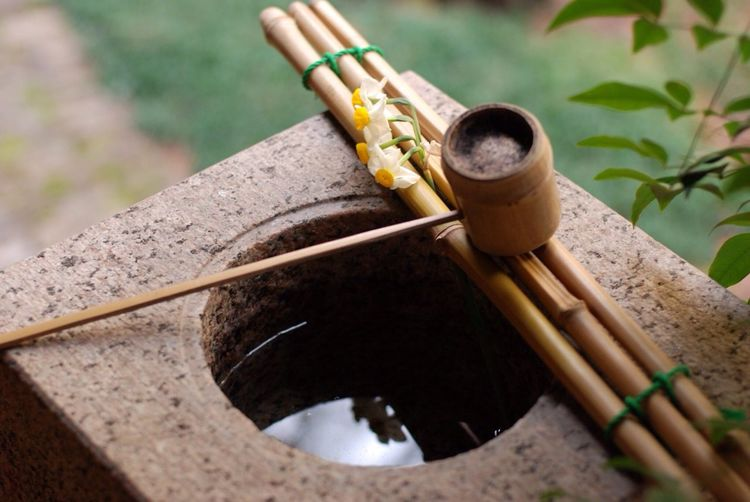 Water Fountain With Bamboo Drinking Ladles