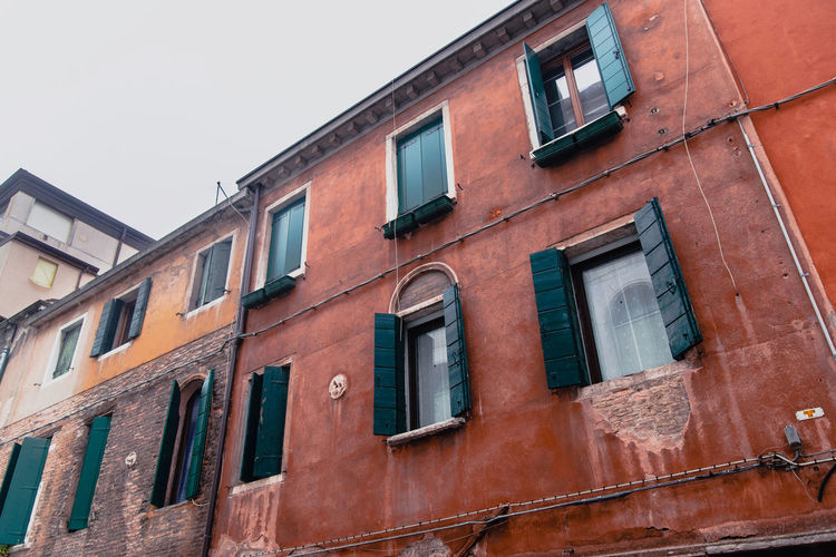 Building Exterior Window Built Structure Architecture Low Angle View Building Sky No People Day Residential District Outdoors Glass - Material Nature Wall In A Row City Old Full Frame Clear Sky Abandoned