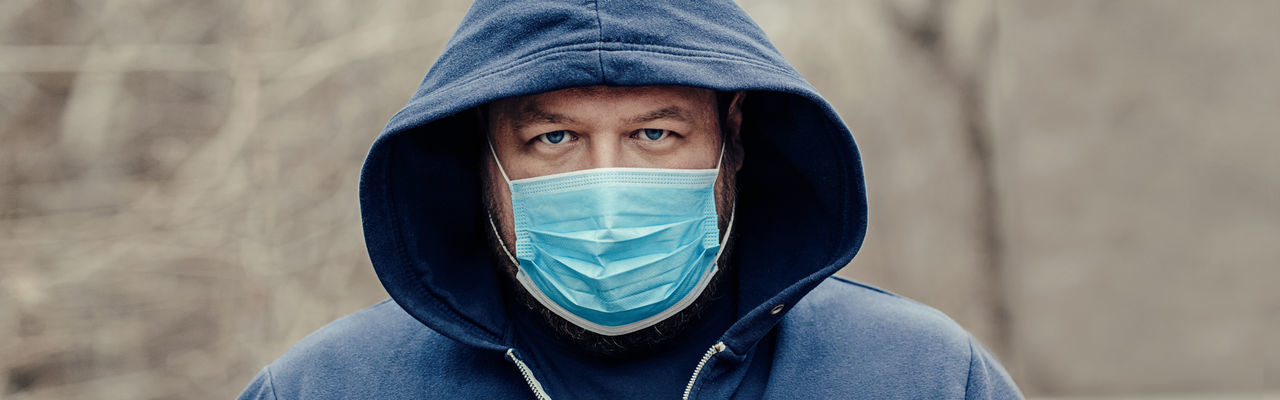 Portrait of man wearing mask standing outdoors