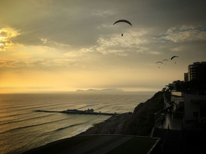 Paragliders and the Pacific Ocean at the Malecon in Lima Lima Sunset Beach Sea Pacific Ocean On A Holiday Peru Travel Traveling IPhone Paragliding