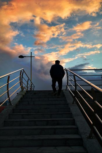Almost there Ibiza, Spain Ibiza Lonely Man On The Road Old Man Railing Steps Steps And Staircases Staircase Real People Full Length Sky Silhouette Sea Leisure Activity Hand Rail Outdoors Lifestyles Cloud - Sky One Person Stairs Day Men Standing Go Higher