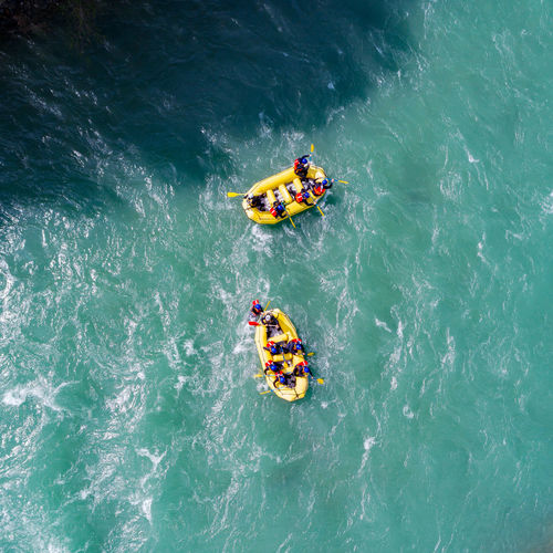 High angle view of people in boat on sea