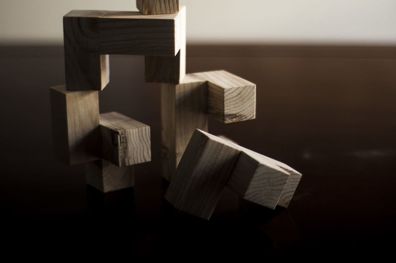 Close-Up Of Wooden Toy Blocks Stacks On Table