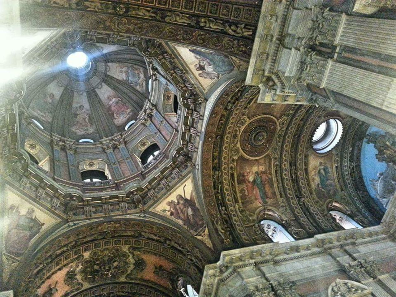 low angle view, religion, place of worship, indoors, architecture, built structure, spirituality, history, ceiling, day, no people, travel destinations, dome
