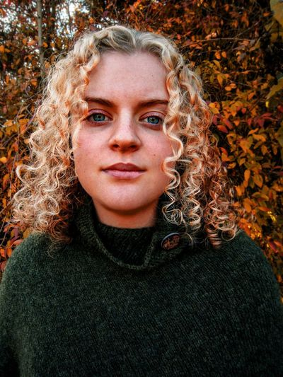 Close-Up Of Woman With Curly Hair