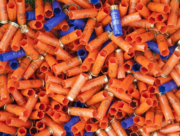 Shotgun shells. Background of many colorful shot empty shotgun shells, blue, red, yellow, purple colored Shotgun Shells. Background Of Many Colorful Shot Empty Shotgun Shells, Blue, Red, Yellow, Purple Colored