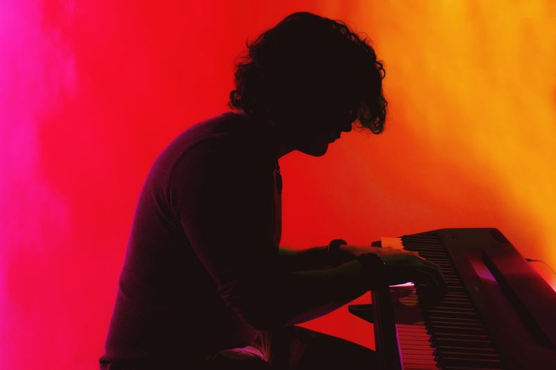 Piano Moments Music Musical Instrument One Person Arts Culture And Entertainment Side View Musician Piano Playing Pianist Performance Human Hand Colors Jazz Music Silhouette Tranquility Happiness Inner Power Inner Power