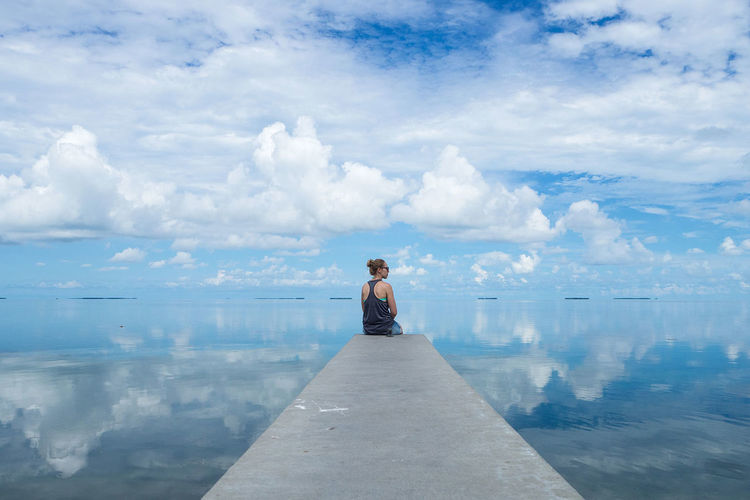 Woman enjoying the scenic view to one of the bridges in the florida keys Beauty In Nature Cloud - Sky Explore Freedom Horizon Over Water Landscape Leisure Activity Nature One Person Outdoor Photography Outdoors Real People Relaxation Roamer Scenics Sea Sky Tranquil Scene Travel Water Women Young Women