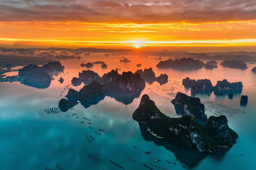 Bai Tu Long Bay Ha Long Beauty In Nature Day Ha Long Bay Nature No People Outdoors Reflection Scenics Sea Silhouette Sky Sunrise Sunset Tranquility Water