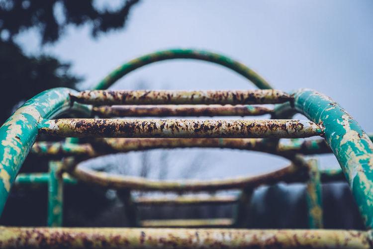 Close-up of rusty monkey bars at playground