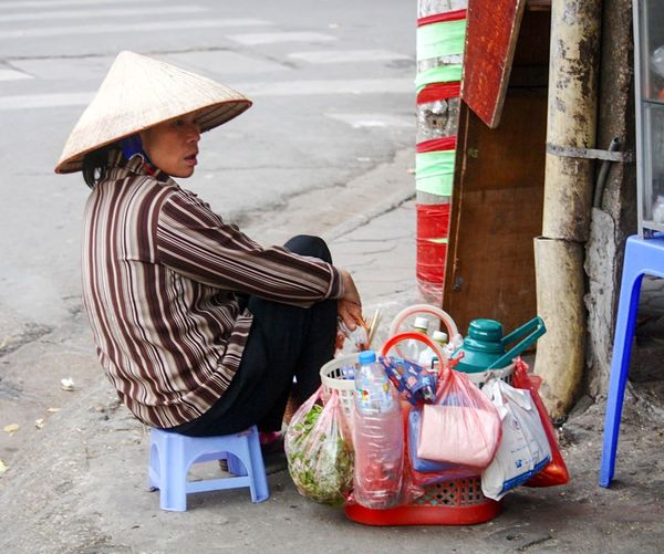 Street Seller Side Of The Road Hanoi, Vietnam Making A Living Street Photography Ba Dinh, Vietnam Conical Hat Taking A Break Plastic Stool Street Food Worldwide