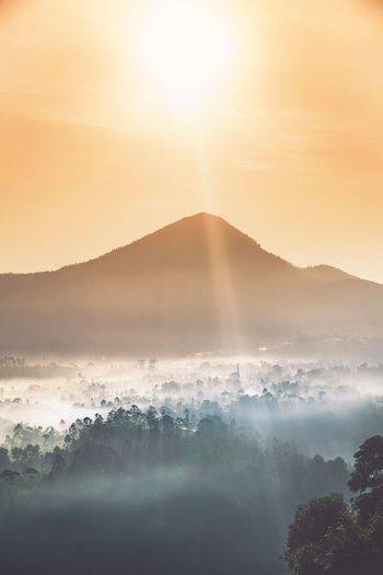 Wonderful sunrise at Bandung, Indonesia Foggy Morning Fog Hill Sunrise Water Beauty In Nature Scenics - Nature Sky Sea Nature Sunset Mountain Sun Land No People Sunlight Power In Nature Outdoors