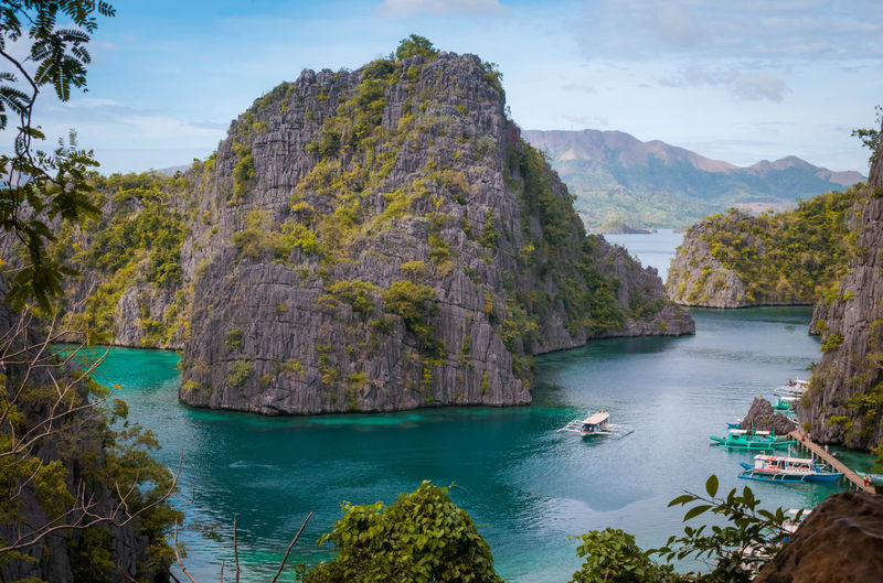 Coron Palawan Philippines Island VacationsEyeEmNewHere Beauty In Nature Tourism Water First Eyeem Photo Adventure Earth Tropical Climate Summer Nikon Limestone Rock Outdoors ASIA Swimming Nature Travel Destinations Travel Scenics Let's Go. Together. 100 Days Of Summer