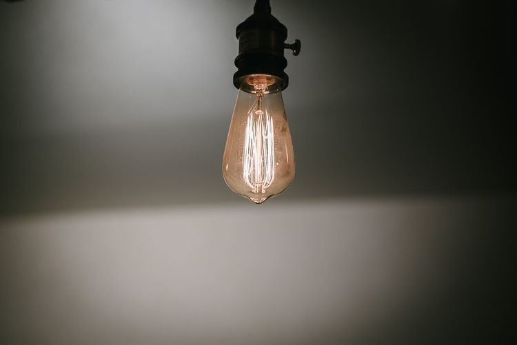 Lighting Equipment Illuminated Electricity  Light Bulb Indoors  Wall - Building Feature Light Electric Lamp Close-up Domestic Room Hanging No People Electric Light Single Object Glowing Light - Natural Phenomenon Dark Filament Low Angle View Vignette