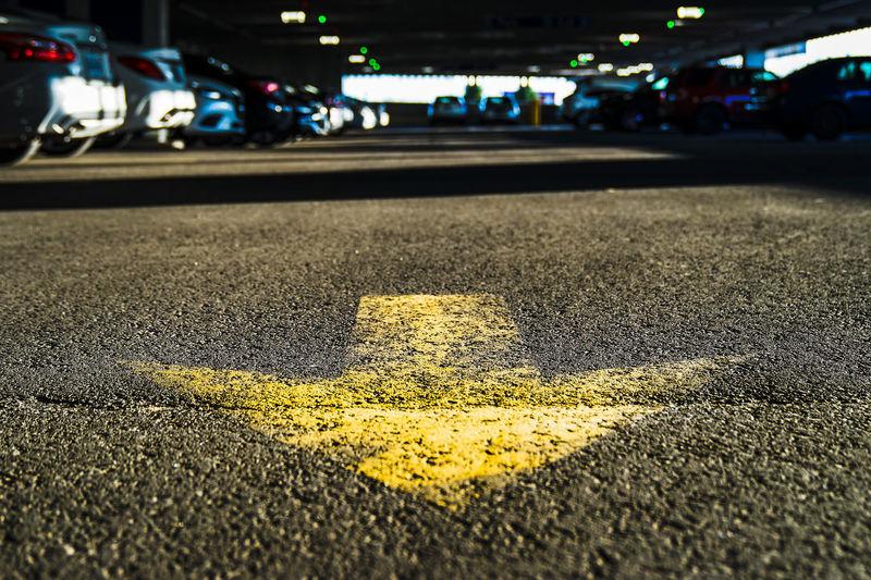 over this way Road Sign City Illuminated Road Yellow Asphalt Guidance Street City Street Car Arrow Sign Road Signal