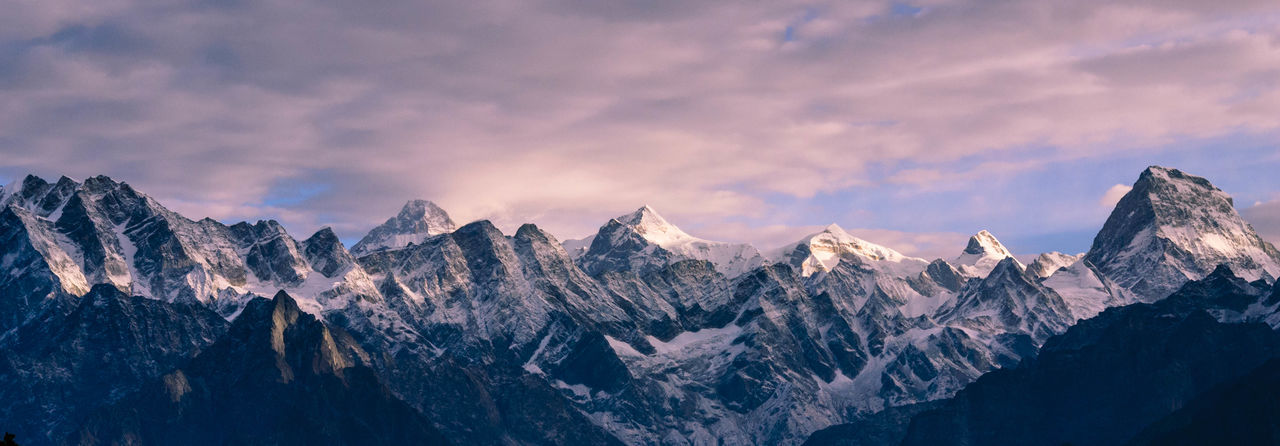 Panoramic view of himalayas against sky during sunset