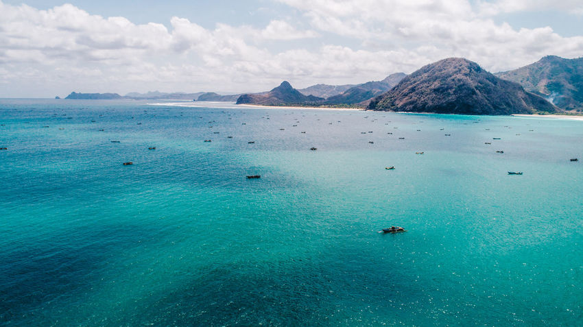 Adventure Beach Beauty In Nature Blue Cloud - Sky Day Dronephotography High Angle View Horizon Over Water Idyllic Mountain Nature No People Outdoors Scenics Sea Sky Tranquil Scene Tranquility Travel Destinations Turquoise Colored Vacations Water Waterfront