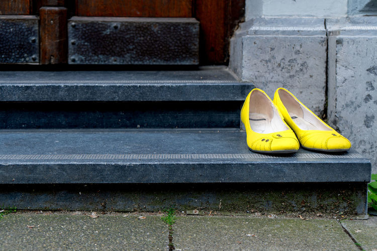 Close-up of yellow shoes on steps