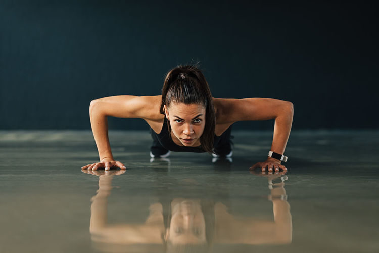 Portrait of woman exercising on floor
