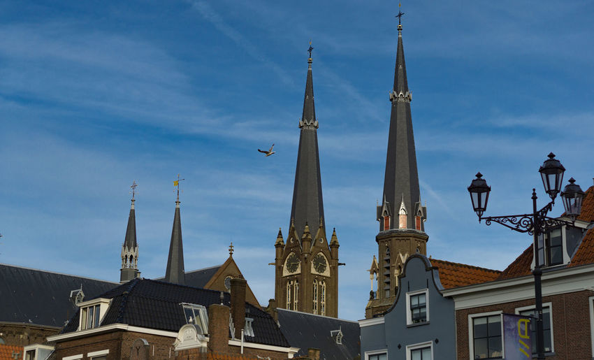 Delft City Center Church City Center Delft Houses Architecture Belief Building Built Structure Gothic Style Holland Low Angle View Medieval No People Outdoors Sky Tower Town Square