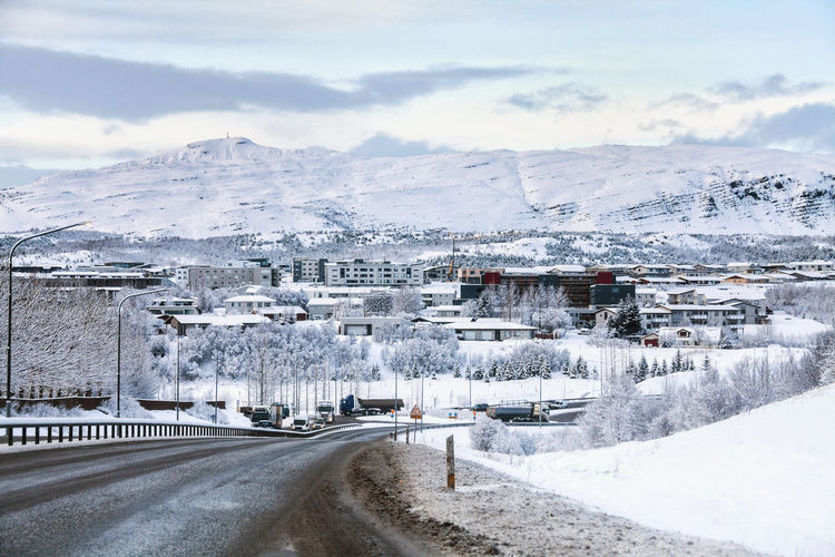 Beautiful and dangerous driving road in winter snow Iceland Architecture Beauty In Nature Building Exterior Built Structure Car City Cloud - Sky Cold Temperature Day Landscape Mountain Mountain Range Nature No People Outdoors Road Scenics Sky Snow Transportation Winter