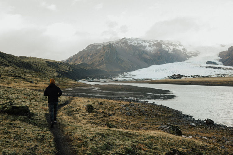 Iceland Adventure Backpack Beauty In Nature Day Full Length Hiking Lake Landscape Leisure Activity Lifestyles Men Mountain Mountain Range Nature One Man Only One Person Outdoors Real People Rear View Scenics Sky Snow Standing Walking Winter