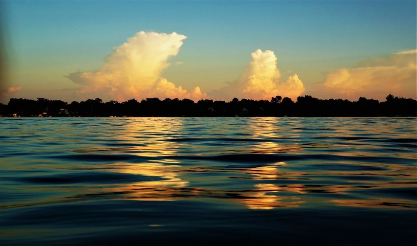Sky Water Cloud - Sky Tranquility Tranquil Scene Scenics - Nature Beauty In Nature Waterfront Sunset Nature Sea Silhouette No People Outdoors Idyllic Rippled Reflection Tree Dusk Cloud Lakeside Scenics Calm Dramatic Sky Storm Cloud Lake Horizon Over Water