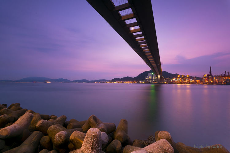 Sunset@Stonecutters Bridge Architecture Beauty In Nature Bridge Bridge - Man Made Structure Built Structure Calm City Cloud Cloud - Sky Connection Engineering Idyllic Illuminated Nature Nightphotography No People Outdoors Reflection River Rock - Object Scenics Sky Sunset Tranquil Scene