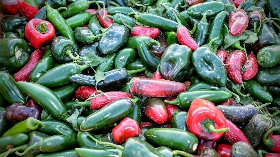 Full frame shot of jalapeno peppers for sale at market