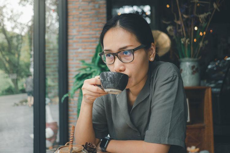 Portrait of woman drinking coffee
