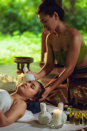 Woman giving massage to client