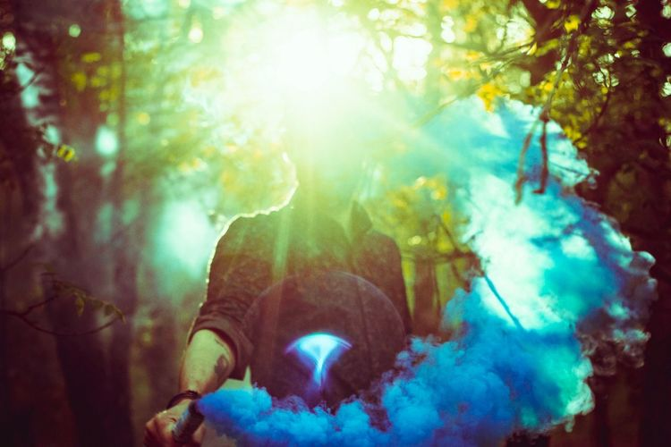 Lens Flare Nature Plant Real People Sunlight Smoke - Physical Structure Tree Leisure Activity Day Indoors  Lifestyles Digital Composite Close-up One Person Sunbeam Multi Colored Capture Tomorrow