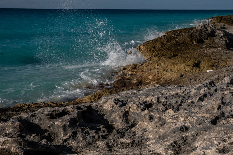 Rock and Sea Sea Water Rock Motion Rock - Object Wave Solid No People Land Beach Beauty In Nature Nature Day Sky Scenics - Nature Outdoors Power In Nature Breaking Rocky Coastline Turquoise Colored Seascape Bimini