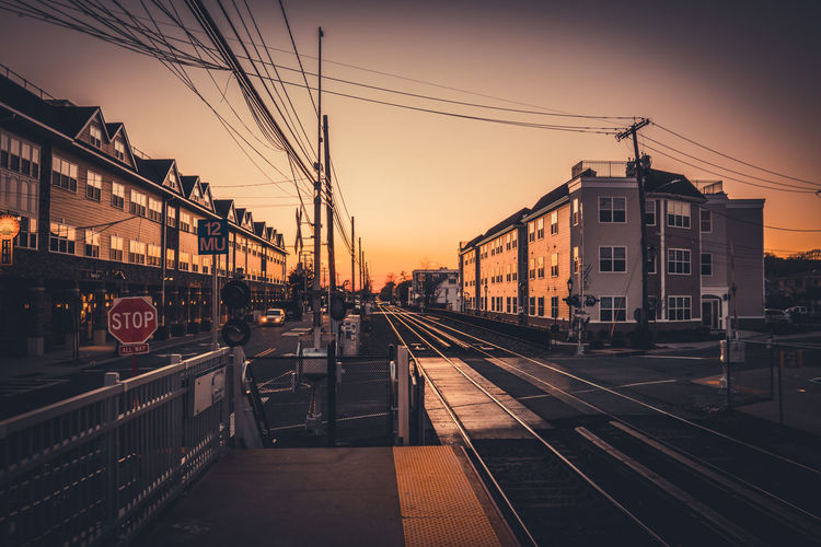 Architecture Building Exterior Built Structure Cable City Day Electricity Pylon Land Vehicle Mode Of Transport Nature No People Outdoors Power Line  Public Transportation Rail Transportation Railroad Track Sky Sunset Train - Vehicle Transportation
